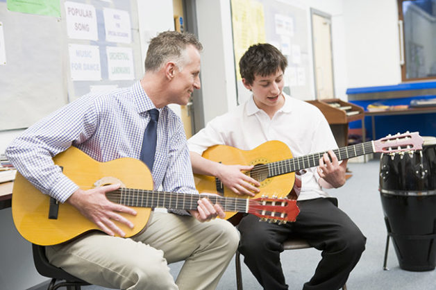 Teaching guitar student chords with Teachers Companion and FileMaker database solution
