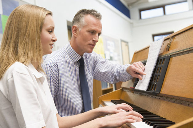 Using Teachers Companion and FileMaker Pro to teach piano with music sheets