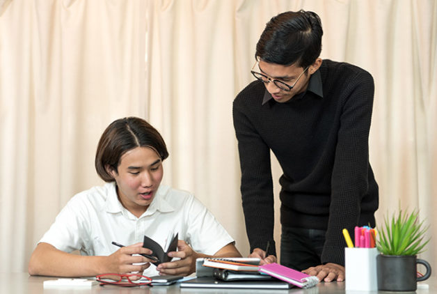 English tutor and student working together on english lessons